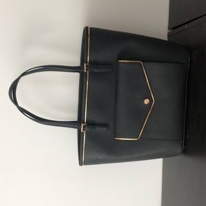 black michael kors tote with gold accents